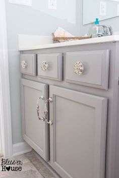 The Beginner's Guide to Painting Cabinets.  An awesome tutorial to follow on how to paint cabinets.   Step by step and products she used.