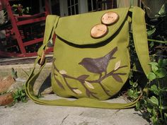 Just got this purse in the mail today, it is BEAUTIFUL!! Love love love it! :) ---Singing Bird on a Branch medium with adjustable shoulder strap by LBArtworks, $55.00