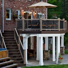 This elevated low-maintenance composite deck features a dry deck space underneath for protected outdoor living. The deck design also uses integrated deck lighting to enhance use in the evening, and ambiance. Patio Under Decks, Deck Patio, Second Story Deck, Raised Deck, Porch And Balcony, Custom Decks, Outdoor Living, Outdoor Decor, Outdoor Spaces