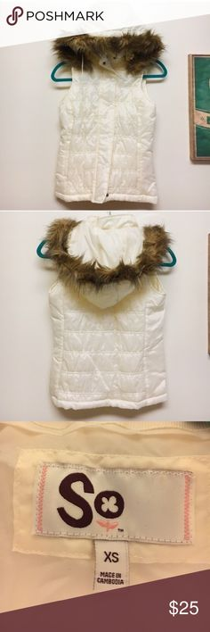 Puffy White Furry Hooded Winter Vest White puffy vest with removable faux fur hood. Perfect to wear over a long sleeved shirt in the winter! Vest zippers down the front and also buttons. Never worn. Jackets & Coats Vests