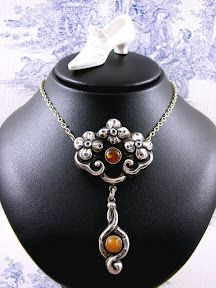 Rare Skonvirke Danish Arts and Crafts Necklace in a Floral Design with Antique Amber Cabochons attributed to maker George Albert Hallling