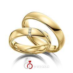 1 Paar Trauringe - Legierung: Gelbgold 585/- Breite: 4,50 - Höhe: 1,60 - Steinbesatz: 3 Brillanten zus. 0,045 ct. w, si (Ring 1 mit Steinbesatz, Ring 2 ohne Steinbesatz)