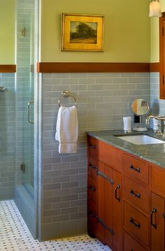 Darling Residence – Colored tile wainscoting with wood trim on top, tile trim on bottom