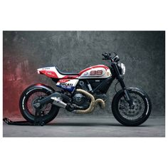 "Ducati Scrambler ""Trackster"": beautiful bike inspired on the MotoGP of Jorge Lorenzo... #ducati #scrambler #tracker #trackster #motogp #jorgelorenzo #99 #jorgelorenzo99"