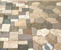 Loving his idea! These stone pavers are made from granite counter top remnants. They cut them into four different sizes so they could integrate them into a number of different landscape design patterns. Great way to recycle and reuse!