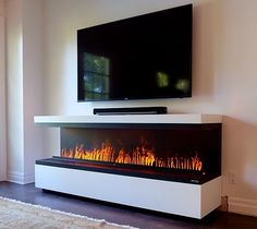 Fireplace with TV above. Water Vapor Technology Opti-Myst by Dimplex. Realistic Electric Fireplace, Modern Electric Fireplace, Wall Mount Electric Fireplace, Electric Fireplaces Direct, Dimplex Electric Fireplace, Custom Fireplace, Fireplace Wall, Fireplace Design, Fireplace Suites