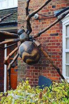 We created a gigantic spider to stick on our client's wall to scare trick or treaters visiting their house. We provide full Halloween Dressing services. Halloween Prop, Halloween Spider Decorations, Outdoor Halloween, Holidays Halloween, Halloween Season, Halloween Crafts, Halloween Ideas, Vintage Halloween Photos, Halloween Entertaining