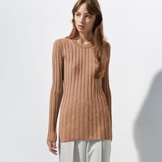FWSS Damn That Valley is a ribbed top crafted from a stretchy cotton fabric. Beige Jumpers, Camel Tops, Fall Winter Spring Summer, Ribbed Top, Cotton Fabric, Bell Sleeve Top, Tunic Tops, Elegant, Sweaters