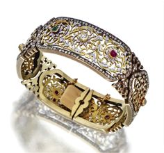 Renaissance revival 18 kt gold, diamond, colored stone and enamel bracelet, French, circa 1880.