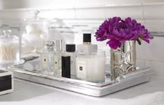 arrangement on a tray: fresh flowers & jo malone candle