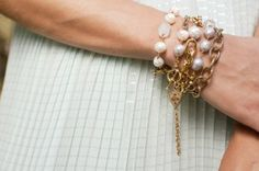 Stack of freshwater pearl bracelets with vintage crystal beads and gold chain tassel by ExVoto Vintage Jewelry.  #bracelet #pearl #handmade