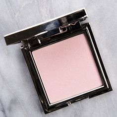 Jouer Celestial Powder Highlighter ($24.00 for 0.16 oz.) is a pale pink with subtle, cool undertones and a lu minous sheen. It has a subtle shift from pink