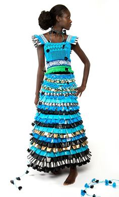 Johanna Törnqvist. Dress: Precious Trash, 2013. Recycled material. Precious trash is made out of recycled material, based on one family consumption of coffe and pasta for 2 months. Trash has been processed and refined to become precious material. With this dress you will shine and at the same time make a statement about your daily consumption of plastic..