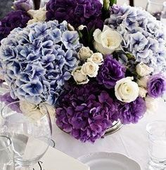 love this color combo, purple, lavender and white for wedding reception centerpieces.