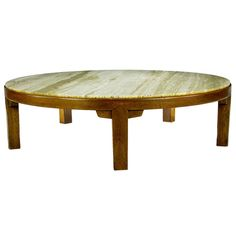 Edward Wormley Round Mahogany & Travertine Coffee Table   USA   Circa 1950s   Rare Edward Wormley for Dunbar five-leg mahogany and travertine coffee table. Exquisite, yet simple, design features chunky solid mahogany legs and corner corbels. Large at four feet in diameter, a substantial and rarely offered Wormley design.