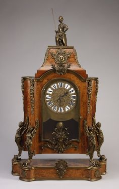 9th century Louis XV style bronze mounted marquetry inlaid clock, featuring a bronze figure of Athena at the crest holding lance and shield...