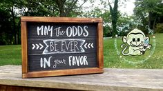 """""""May The Odds Be Ever In Your Favor"""" Graduation Gift.     10""""x7"""" Reclaimed Wood Signage painted/ lightly distressed black background with White text. Free standing on a thick, torched and stained wood frame. Www.facebook.com/monkeyfingerscrafts"""