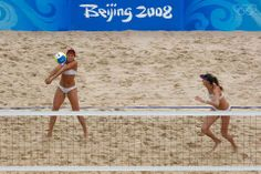 Women's beach volleyball action from the Beijing Olympics. Misty May-Treanor passing to Kerri Walsh. They went on to win the gold medal in Beijing. They also won gold in Athens in 2004.