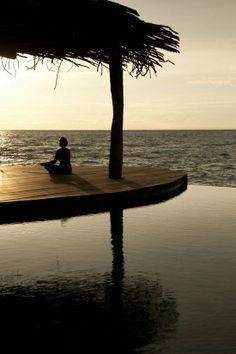 Simple over the water meditation platform with thatched roof.    Song saa island cambodia