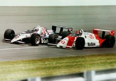 Al Unser Jr in his Valvoline Galles takes it to Emerson Fittipaldi in a Marlboro Penske. Little Al won Indy in '92 and '94.