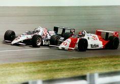 Al Unser Jr in his Valvoline Galles takes it to Emerson Fittipaldi in a Marlboro…