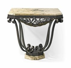 PAUL KISS (1885-1962) CONSOLE, CIRCA 1925 wrought and gilt iron, marble 33 in. (84 cm.) high; 33¾ in. (85.6 cm.) wide; 24½ in. (62.4 cm.) deep stamped PAUL KISS FRANCE