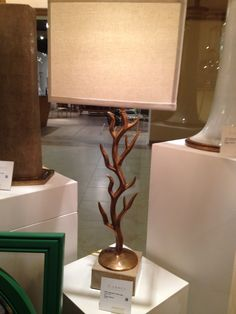 the stand of the lamp is similar to to a tree that creates a natural feel to be added into a room