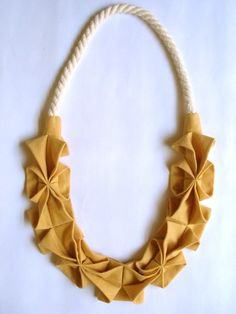 Origami Hana Necklace: I REALLY want this origami rope necklace. The perfect punch to my uniform of choice these days, a white v-neck tee and jeans.