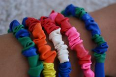 balloon bracelets: deflated skinny long balloons cut into segments are threaded onto elastic