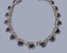 Margot De Taxco Sterling Silver Amethyst Necklace, C.1950.   From a unique collection of vintage more necklaces at https://www.1stdibs.com/jewelry/necklaces/more-necklaces/
