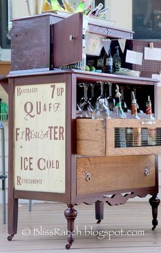 I like the idea of making a bar out of a dresser and adding vintagy bar signs to make it unique and bar like.