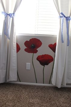 Our finished Wizard of Oz nursery - poppies under the window.