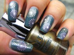 Trying out stamping nail art! OPI's I Have a Herring Problem as the base with Ulta's High Roller and LA Colors Art Deco polish in Baby Pink for the stamped flowers.