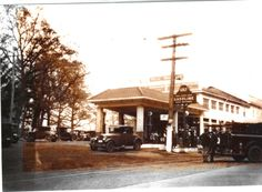 Late 1920's front with Gulf Gasoline drive-through filling station. Note the unpaved dirt road on Rockville Pike and trolley tracks.