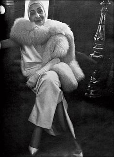 "Germaine Émilie Krebs (1903–1993), known as Alix Barton and later as ""Madame Grès"", launched her design house under the name Grès in Paris in 1942. Formally trained as a sculptress, she produced haute couture designs for an array of fashionable women, including the Duchess of Windsor, Marlene Dietrich, Greta Garbo, Jacqueline Kennedy, and Dolores del Río. Her signature was cut-outs on gowns that made exposed skin part of the design, yet still had a classical, sophisticated feel."