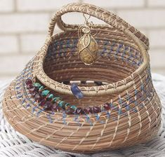 Contemporary Coiled Pine Needle Basket with gemstones, spilling coils, loops, beads