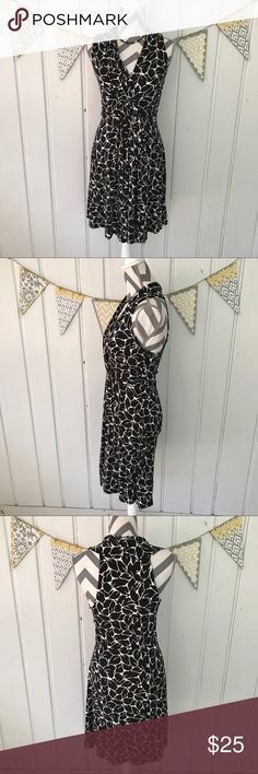 Loft Black and White Cross Top Dress Flattering and comfy Loft dress. Excellent gently used condition. Has a crossed top with a piece of twisted fabric on one side of the cross cross. It is a black and white dress featuring a leaf pattern. LOFT Dresses