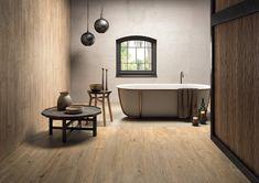 Pour une salle de bains chaleureuse at authentique, mettez une petite touche de bois ! Les revêtements de sol en grés cérame ont la côte et imitent parfaitement le bois avec un choix de nuances très varié. Besoin d'inspirations ?  Un projet d'aménagement ou de rénovation ? Contactez-nous!  #bois #wood #grescerame #salledebains #bains #bathroom #deco #design #interieur #maison #decoration #scandinave #nature #carrelage 9 Mm, Wood Effect Porcelain Tiles, Wood Effect Tiles, Background Tile, Steam Showers Bathroom, Rustic Contemporary, Wall And Floor Tiles, Clawfoot Bathtub, Wooden Flooring
