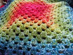 colour in a simple life: Graduated Granny Blanket - multiple strands of yarn that individually change color as you go - right up my ally