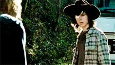 {Open: Carl} i was outside, yet again. I just couldn't stay in the compound. I was walking near a forest that kind of traumatized me. I went to the spot where we lost Glenn and Abraham. The blood stains were still there. Once I looked up, there was a walked coming close to me. I had gotten my knife out, when the body dropped, and you were standing above it.
