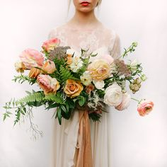 Inspired by colors of the sunset, this concept brought to life by Refine  Studios and photographed by Mandi Nelson is filled with some shining star  spring blooms like these huge Japanese ranunculus and tan lisianthus.  HAMU: Celise Artistry  Cake: Le Loupe Cakes  Gown: Truvellebridal