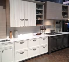 Muted neutrals are hot at the 2015 #KBIS, including this kitchen from MasterBrands with 4 different cabinet finishes!