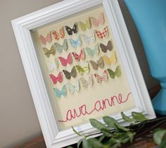 Nursery decor gift -a birth-date written on one butterfly, and the name hand stitched beneath. For those of us who remember nursery cross stitches with nostalgia, but aren't so handy with a needle :).
