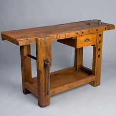 """French Country Rustic Etabli This Rustic Carpenter's Etabli """"Workbench"""" is small in size and was probably used by the carpenter's apprentice.  It is made of sycamore wood with one drawer and the original clamp.  The depth of the workbench without the clamp is 16.75"""".  Perfect as a console table or wine serving table."""