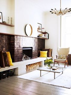 Living room with fireplace and white rug.