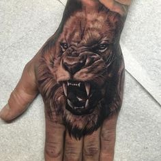 Ash Higham Lion Tattoo on hand at Rapture Studio