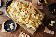 Blue Cheese Potato Chips. Broil potato chips drizzled with a creamy blue cheese sauce. Serve with lots of napkins.