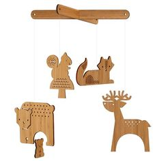 Petit Collage Bamboo Mobile: Petit Collage's bamboo forest mobile ($58) features simple yet sweet forest friends, laser cut from sustainably harvested bamboo.