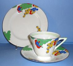Doulton deco: Felicity tea trio, H5282, Rd776716, c1934 (7). Stylised fruit, flowers and foliage design in bold primary colours with lime green bands and highlights and gold gilt trim.