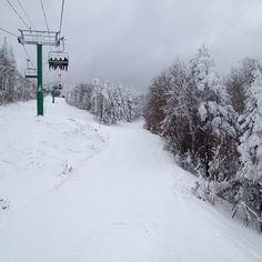 On the lift #burkemountain #vermont #trail #snowboarding #mountain #trees #snow #clouds #skilift